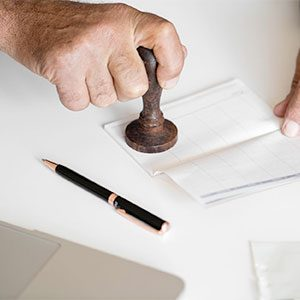 man stamping a document