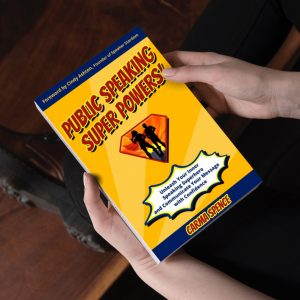 Someone holding a copy of Public Speaking Super Powers